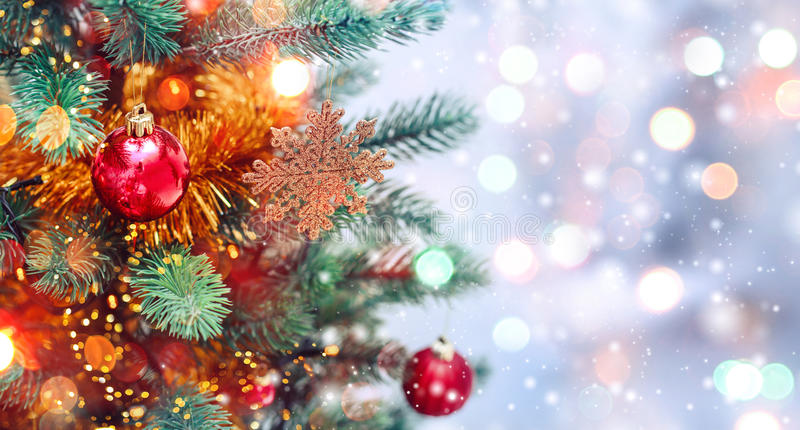 Christmas tree background and Christmas decorations with snow, blurred, sparking, glowing. Happy New Year and Xmas. Theme royalty free stock images
