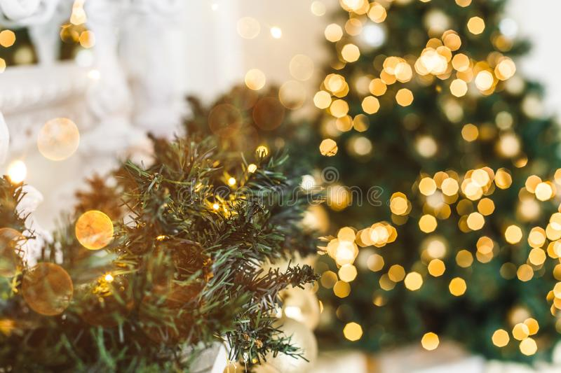 Christmas tree background and Christmas decorations, blurred, sparking, glowing. Happy New Year and Xmas theme royalty free stock photography