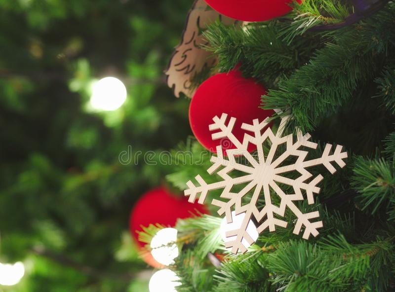 Snowflake and red ball hanging on Christmas tree with light up. Christmas, tree, background, new, decoration, holiday, red, xmas, design, blurred, celebration stock photography