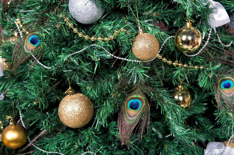 Christmas Tree With Baubles Peacock Feather Garlands Stock