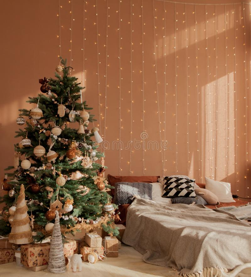 Christmas tree by the bed. Holidays, present, childhood, happiness concept. Christmas tree by the bed. Holidays, present, childhood happiness concept royalty free stock image