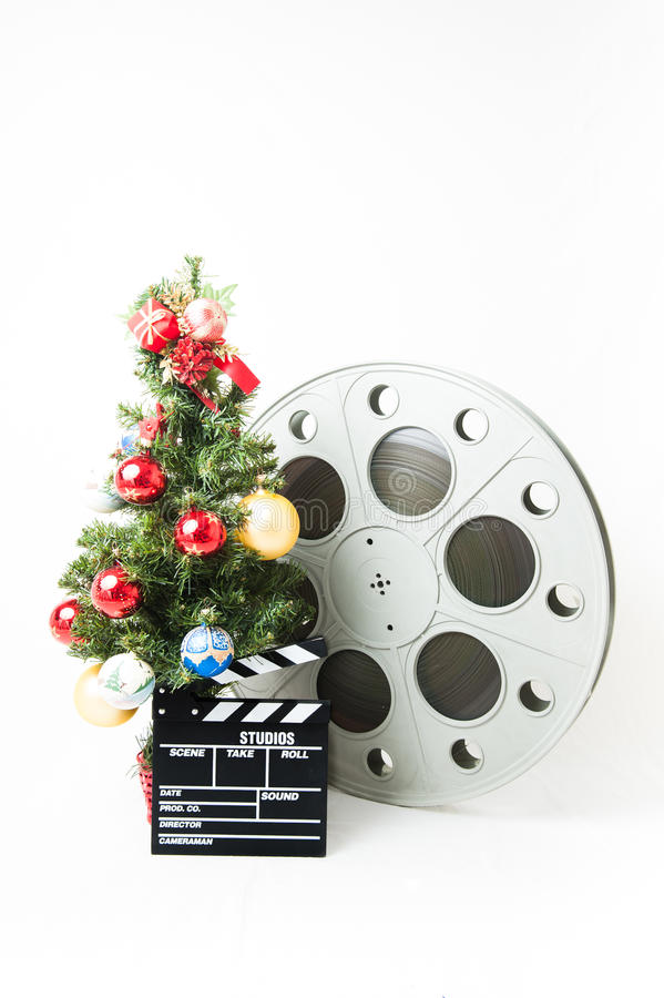 Christmas tree with big cinema reel and movie clapperboard stock images