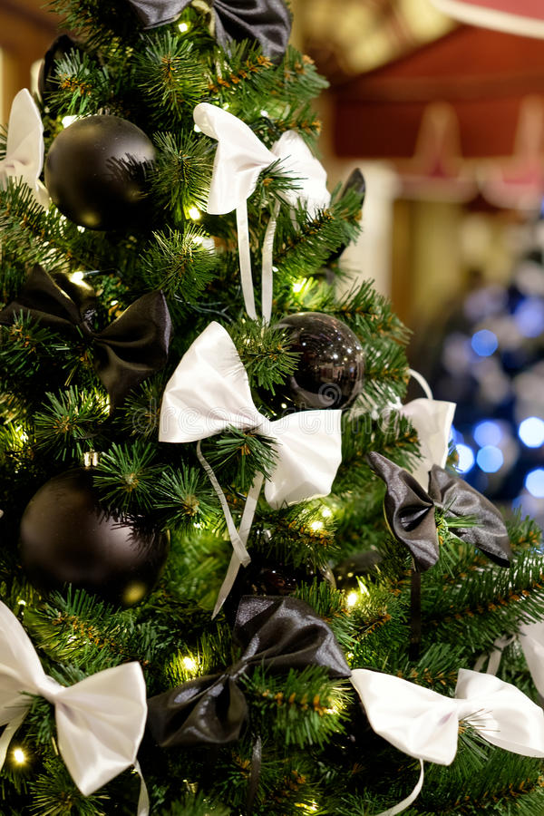 Download Christmas Tree With Black Balls And Bows. Stock Image   Image Of  Golden,