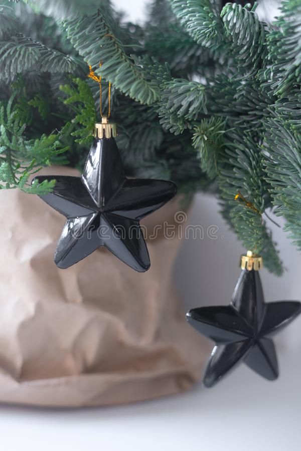 Christmas tree with black decorations stock photo