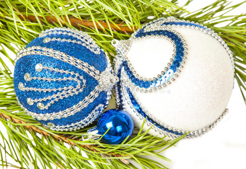 Christmas tree and blue ball with white glitter. On white royalty free stock photo