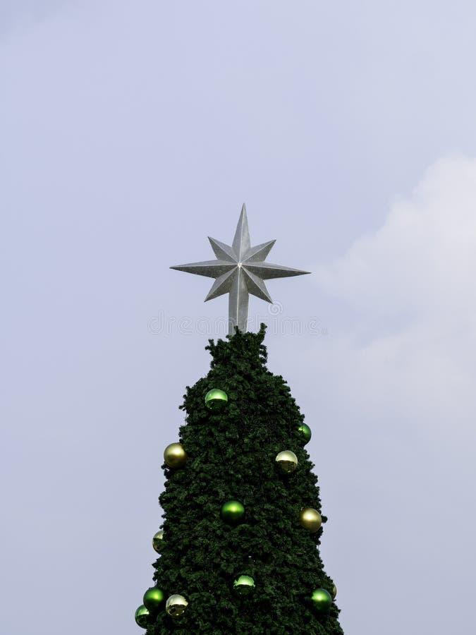 Christmas tree on blue sky stock photos