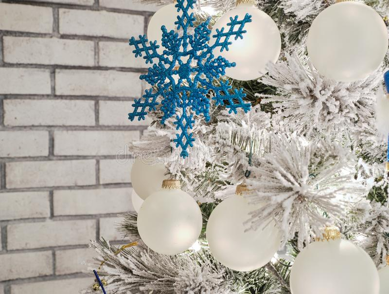 Holiday tree with blue and white ornaments decorated for the thanksgiving and christmas holidays royalty free stock images