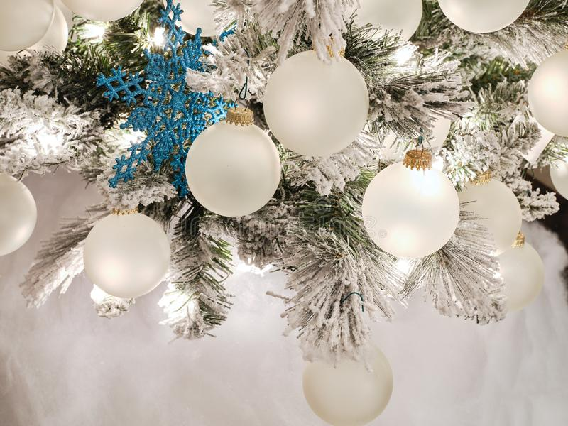 Tree with blue and white ornaments decorated for the thanksgiving and christmas holidays stock image