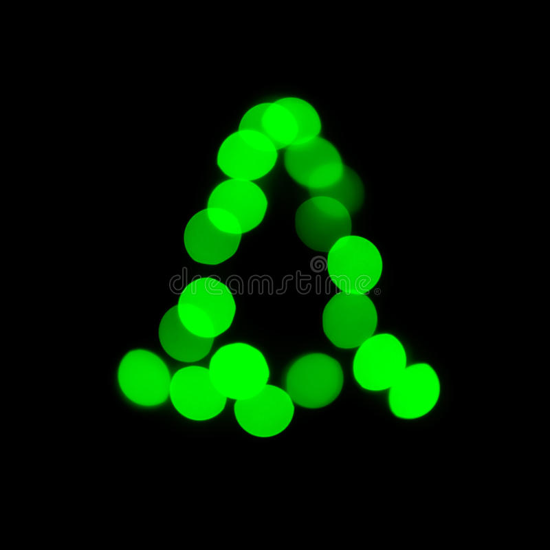 Christmas tree blur. Green christmas tree made with defocused lights on black background stock image