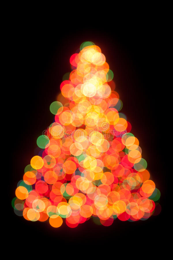 Christmas tree bokeh light. Isolated on black royalty free stock images