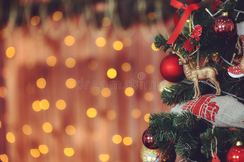 Christmas tree and bokeh light abstract holiday background, vintage toned royalty free stock images