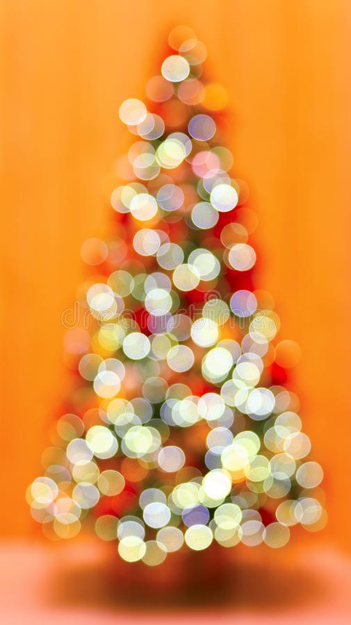 Christmas tree bokeh. Vibrant out of focus christmas tree background