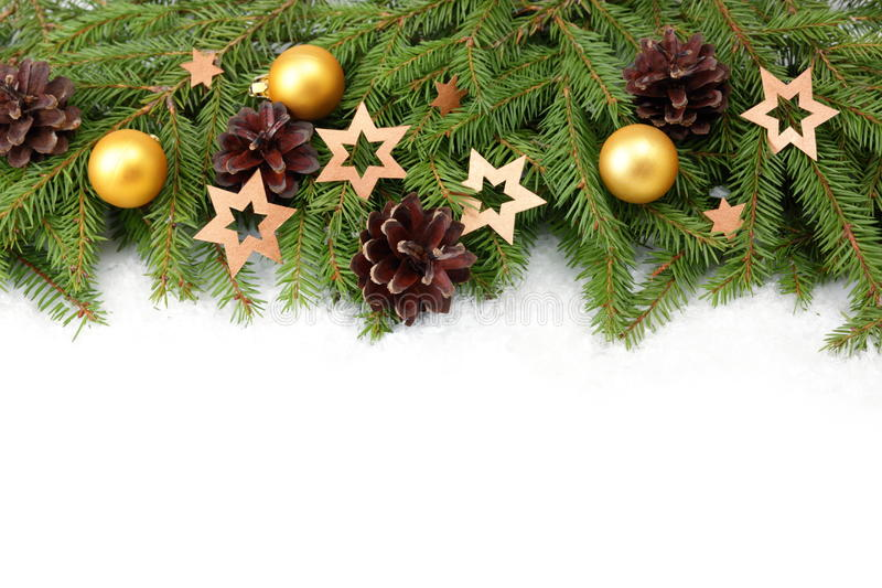 Christmas tree border. With decorations on white royalty free stock images