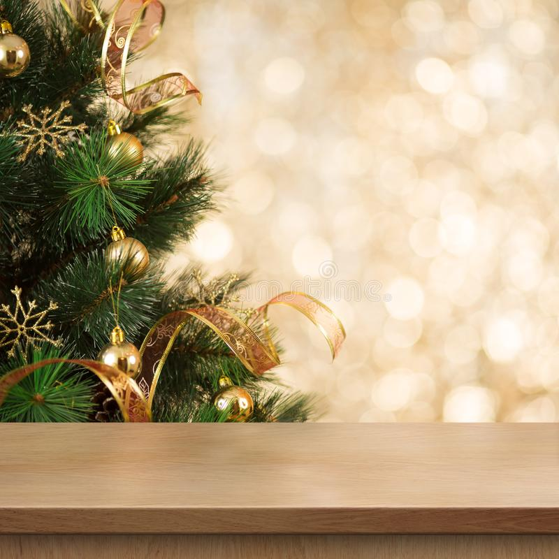 Christmas tree branch behind empty wood table or shelf royalty free stock image