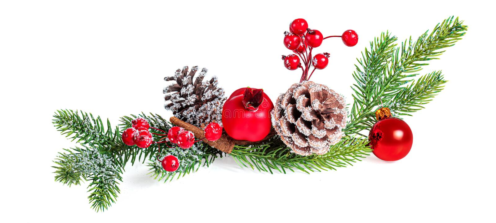 Christmas Tree Branch with Berries, Pine cone and red ball isolated on white background. Xmas Garland. New year Decoration royalty free stock images