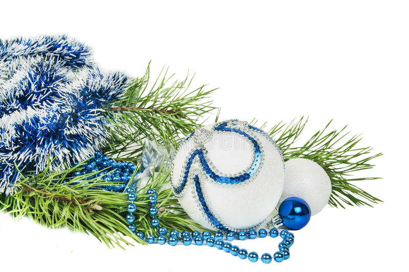 Christmas tree branch and blue ball with white glitter isolated. On white royalty free stock photos