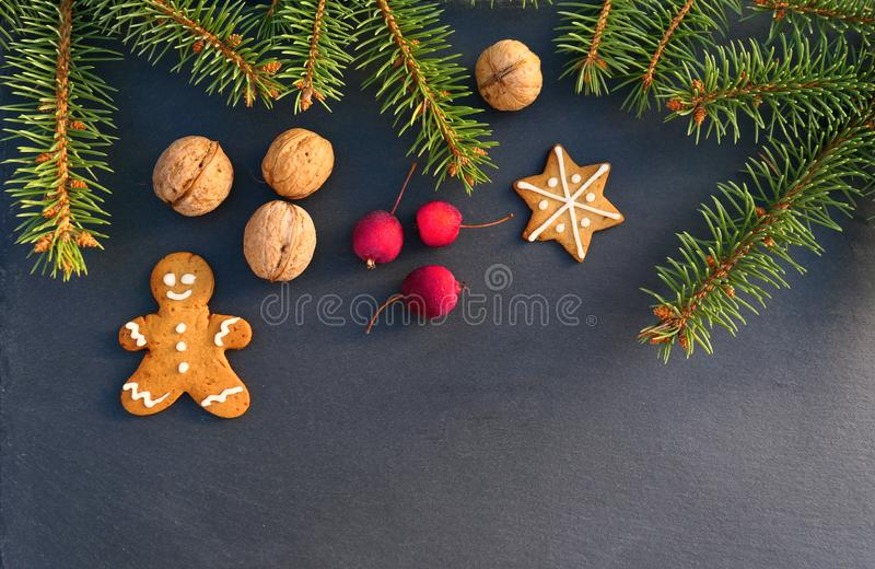 Christmas tree branch border with gingerbread man royalty free stock image