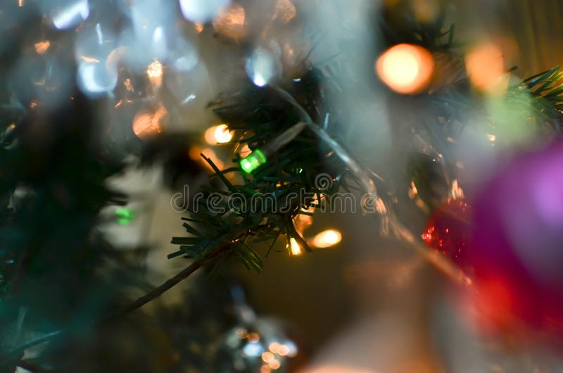 Christmas tree branch with glowing lights stock photos