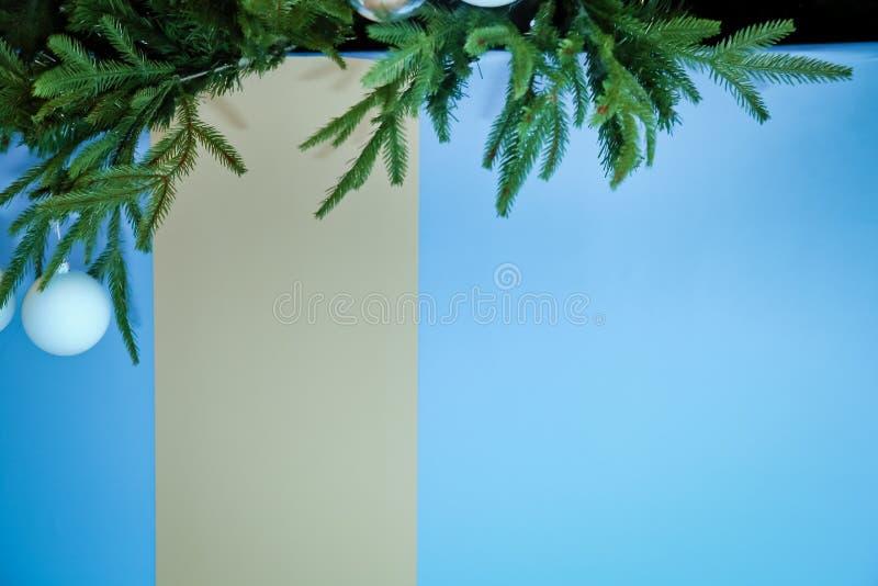 Christmas tree branches with blue baubles, snowflakes on white - horizontal border . Border of Christmas tree. Tree branches with blue baubles, snowflakes on stock photos