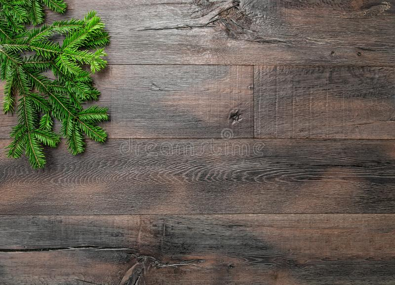Christmas tree branches dark wooden background stock images