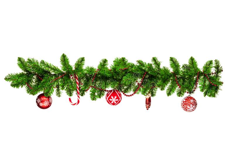 Christmas tree branches with red baubles, golden stars, snowflakes isolated on white - horizontal border.  stock photos