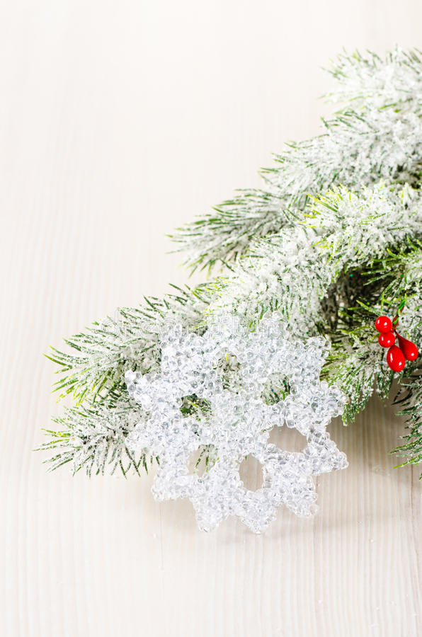Christmas tree branches with snow flake