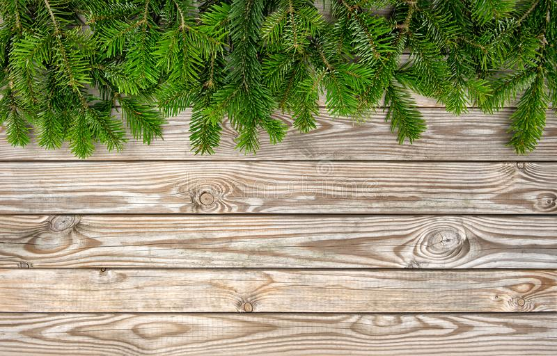 Christmas tree branches wooden background Winter holidays border royalty free stock photography