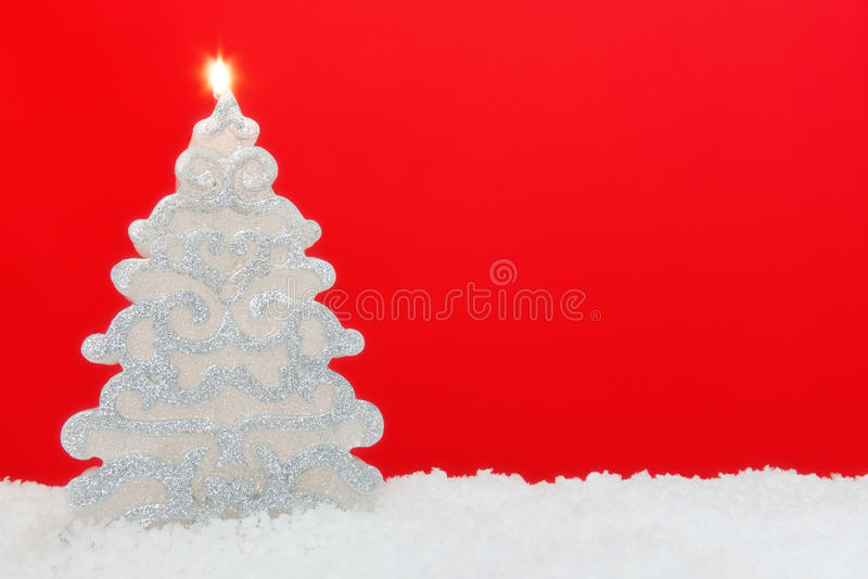 Christmas tree candle red background
