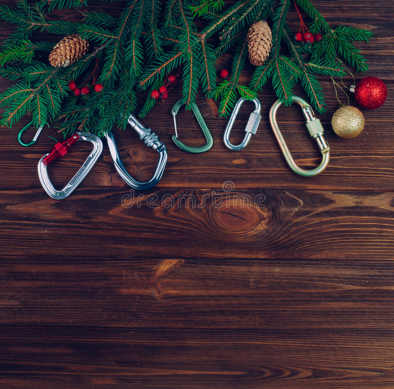 Download Christmas Tree With Carabiners Over Wood Background Stock Photo - Image of accessory, brown: 83712890