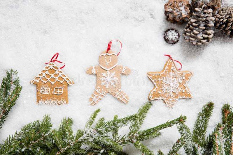 Christmas tree celebration decorations on winter snow for holiday announcement stock images