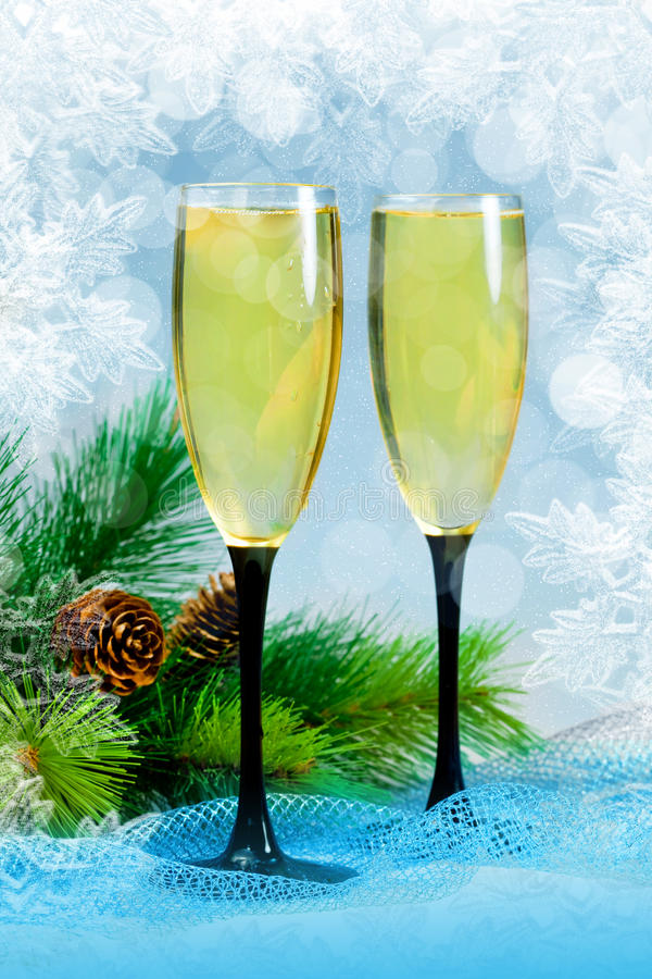 Christmas tree and champagne in glasses stock photo