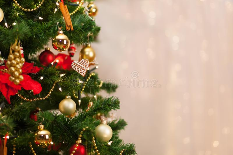 Christmas tree and Christmas decorations on background of de-focused lights stock images