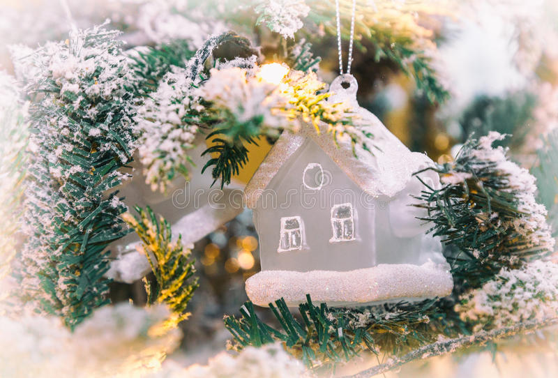 Christmas tree Christmas decorations. Closeup of Christmas toy hanging from a decorated Christmas tree, retro filter effect stock photography