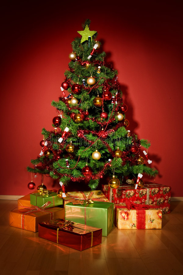 Christmas tree with christmas gifts in red room royalty free stock photo