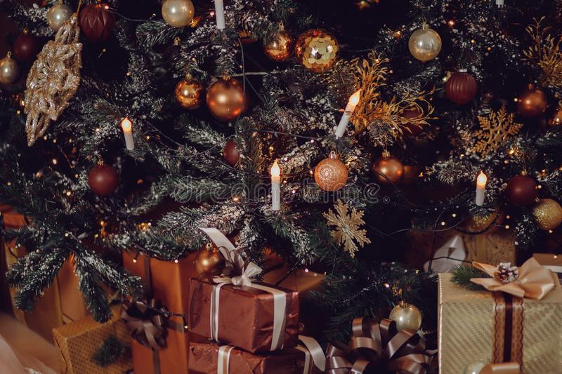 Christmas tree close-up on beautiful expensive brown wooden stock photography