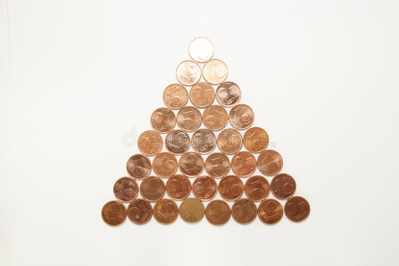 Christmas tree of coins. Christmas tree of bronze euro cents isolated on white stock photos