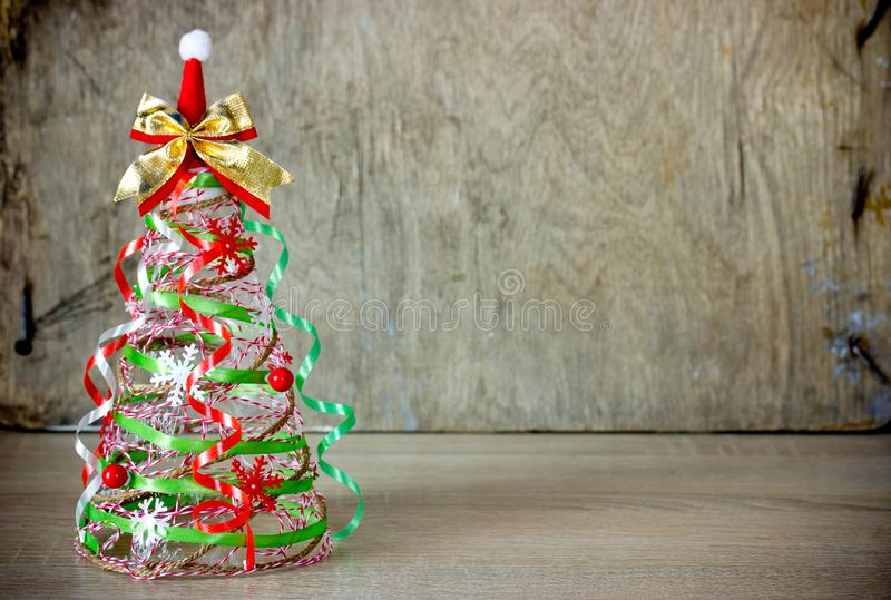 Christmas tree cone from rope and green red ribbon royalty free stock photos