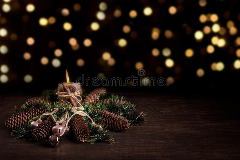 Christmas tree and cones decorated with burning candle and boke. Christmas holiday celebration stock photo