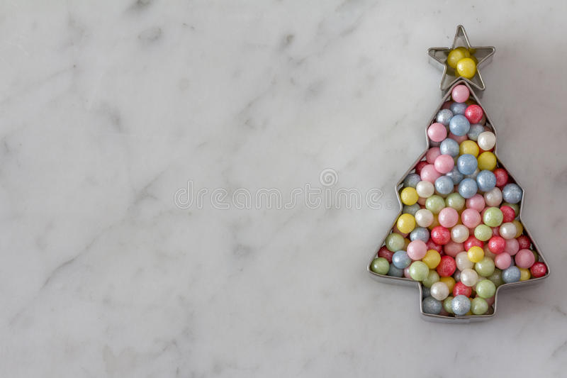 Christmas Tree Cookie Cutter with Sugar Pearls royalty free stock photos
