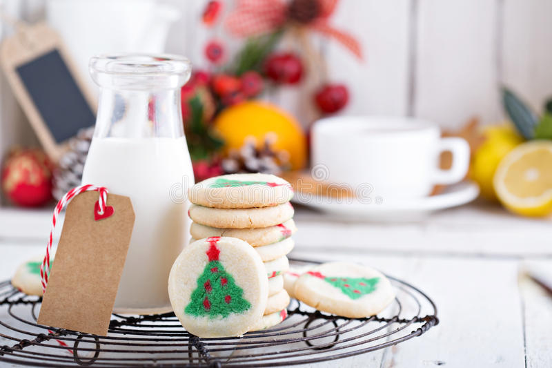 Christmas tree cookies with milk. On a cooling rack stock photos