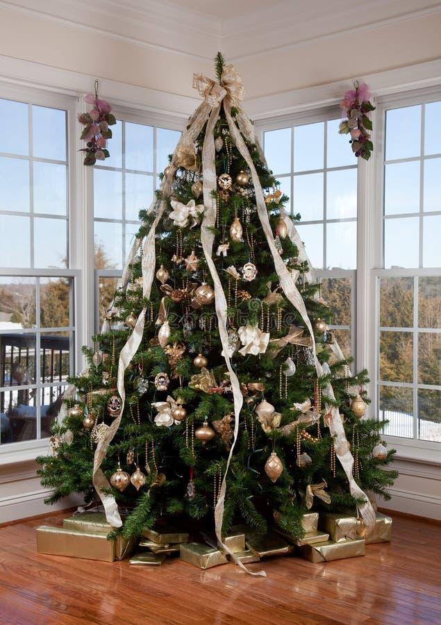 Christmas tree in the corner stock photos