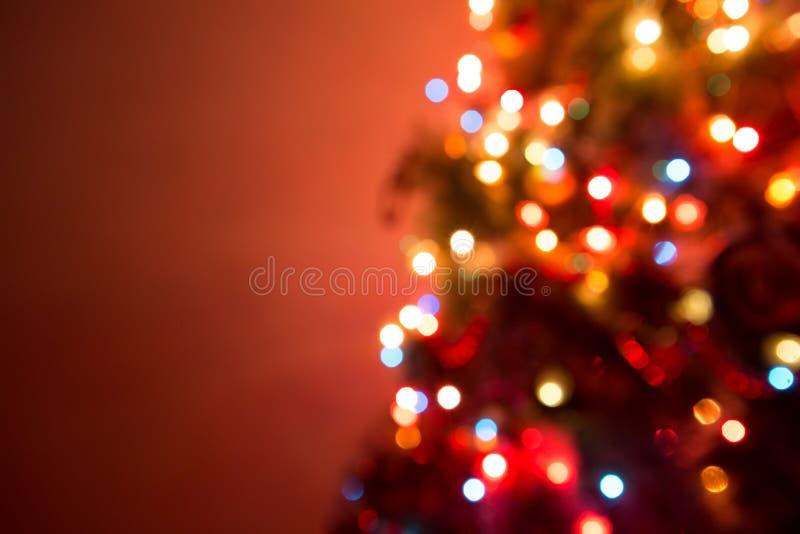 Christmas Tree creating a wonderful bokeh of lights. Christmas lights hanging in a tree creating a wonderful bokeh of lights stock image