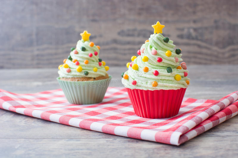Christmas tree cupcake. S on a wood table royalty free stock images