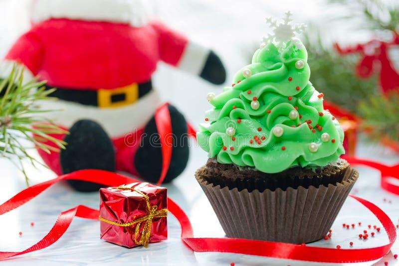 Christmas tree cupcake with green cream frosting. Beautiful chocolate cake shaped fairy Christmas tree royalty free stock photos