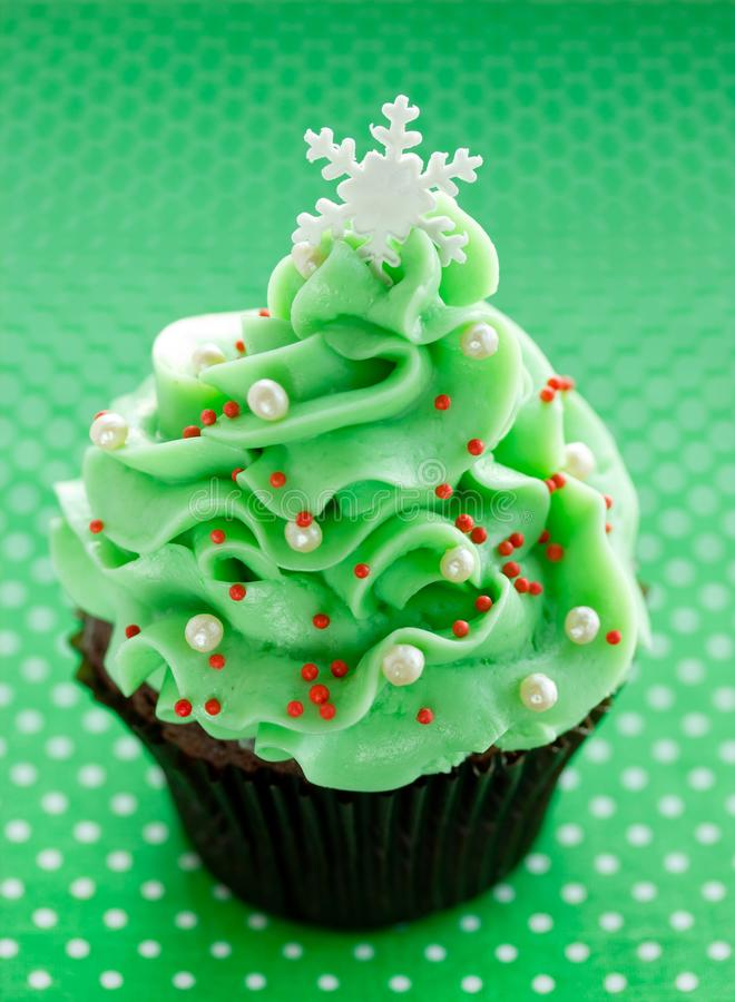 Christmas tree cupcake with green cream frosting. Beautiful chocolate cake shaped fairy Christmas tree royalty free stock images
