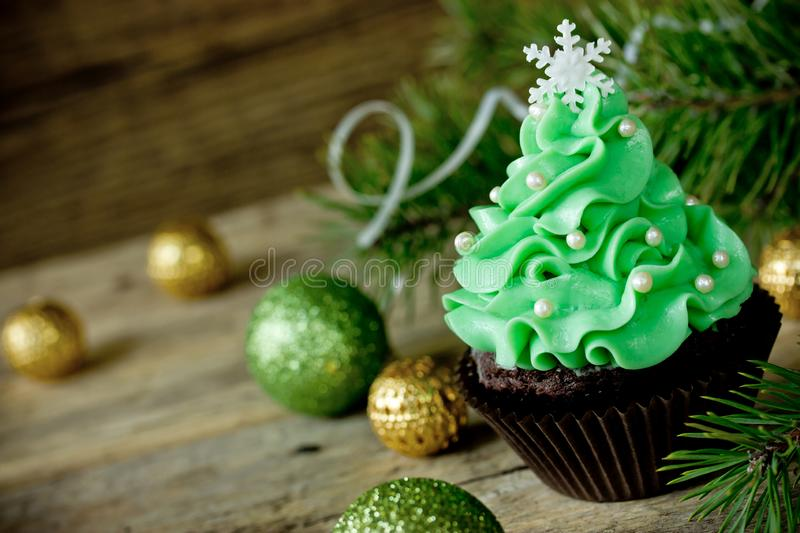 Christmas tree cupcake with green cream frosting. Beautiful chocolate cake shaped fairy Christmas tree royalty free stock photography