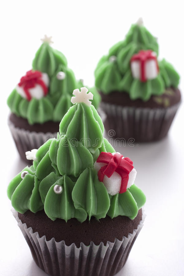 Christmas tree cupcake on white background. Christmas tree cupcake decorating with gift box on white background royalty free stock photography