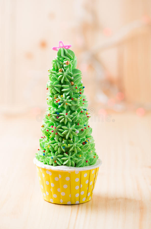 Christmas tree cupcake. On wood background royalty free stock photo