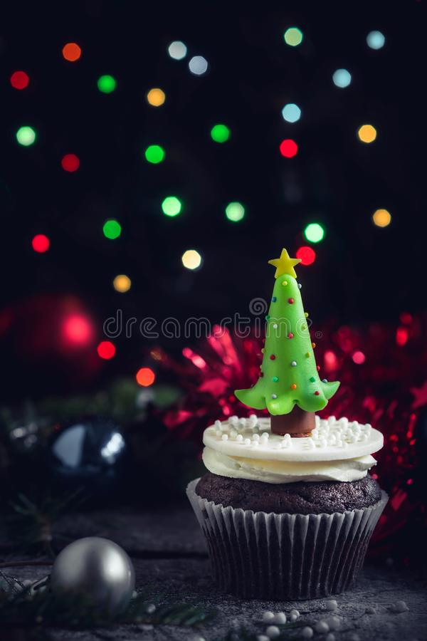 Christmas tree cupcake. On wooden background,selective focus stock image