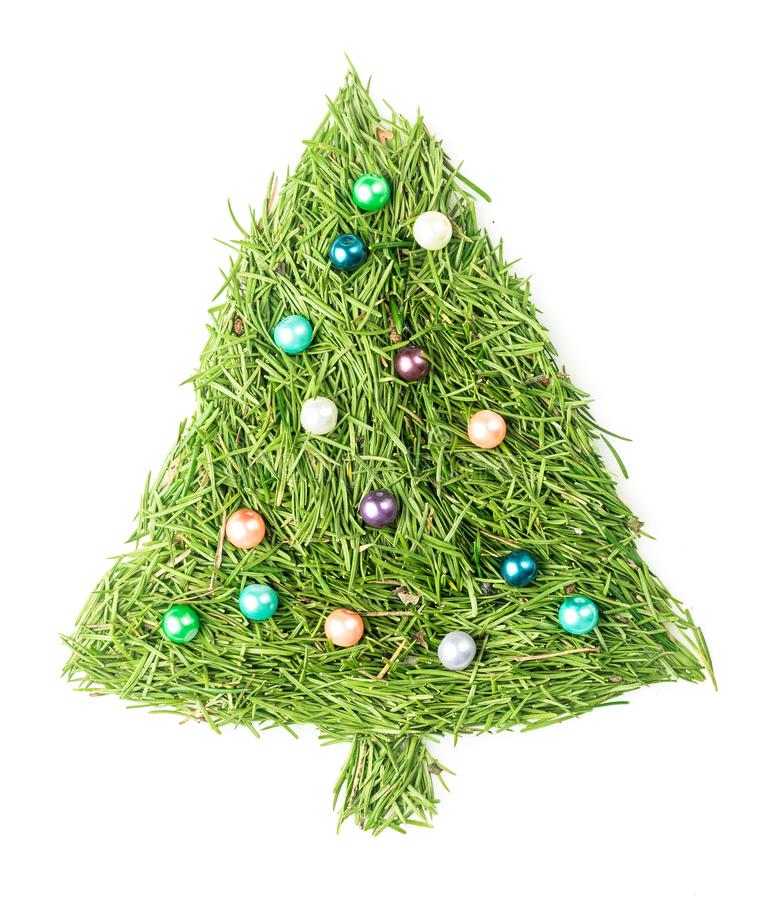 Christmas tree decorated. Christmas tree made of needles and decorated with beads on isolated white stock images